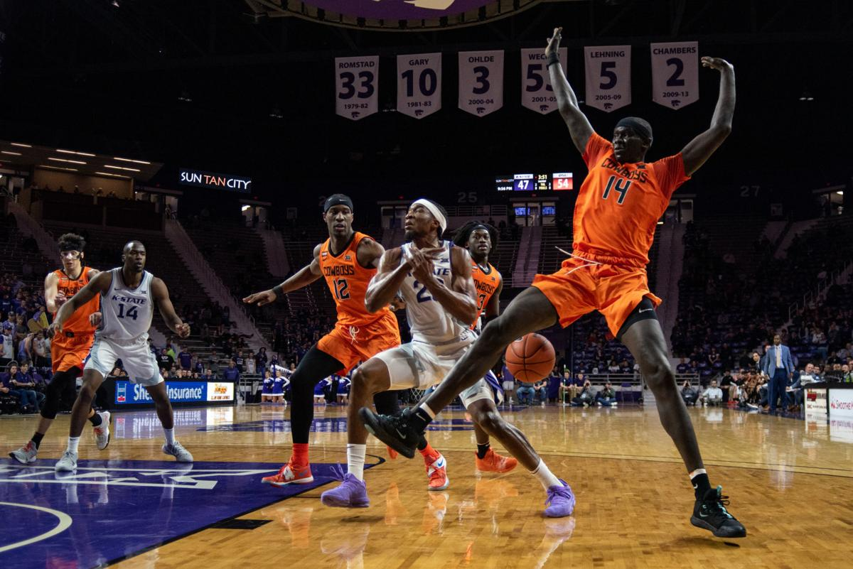The ball is knocked loose out of Xavier SneedÕs (20) hands by Yor Anei (14) during a K-State drive with under five minutes in the second quarter.
