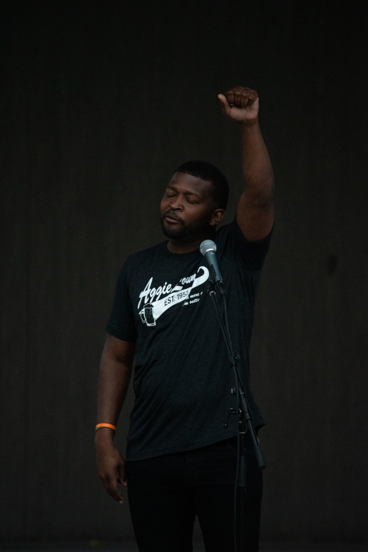 Tory Harris raises his fist while speaking on stage at Wefald Pavilion in City Park before the Flashlight Vigil on Friday. ÒI tell you she (Jaynae Cole) played the song Glory and I donÕt know if your fist was up. How many peopleÕs fist was up? ThatÕs a five minute song, in around two minutes and thirty seconds seconds, what did you feel in that arm?Ó asked Harris. ÒWhatever you felt in that arm, for two minutes and thirty seconds, it was a five minute song and in my head I told myself Tory keep it up. Keep it up! This is all you gotta do right now is keep this arm up. But it takes a little bit more than thatÉ you have to say enough is enough. You have to have that strength to turn around and say enough is enough. Like Mrs. Teresa said, we can be angry but it wonÕt help win anybodyÕs hearts,Ó he added.