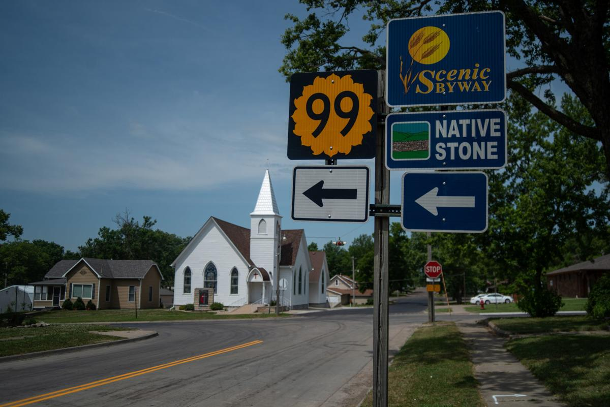 A sign points to the direction of the Native Stone Scenic Byway in Alma, Kansas on West Seventh Street in Alma, Kansas.