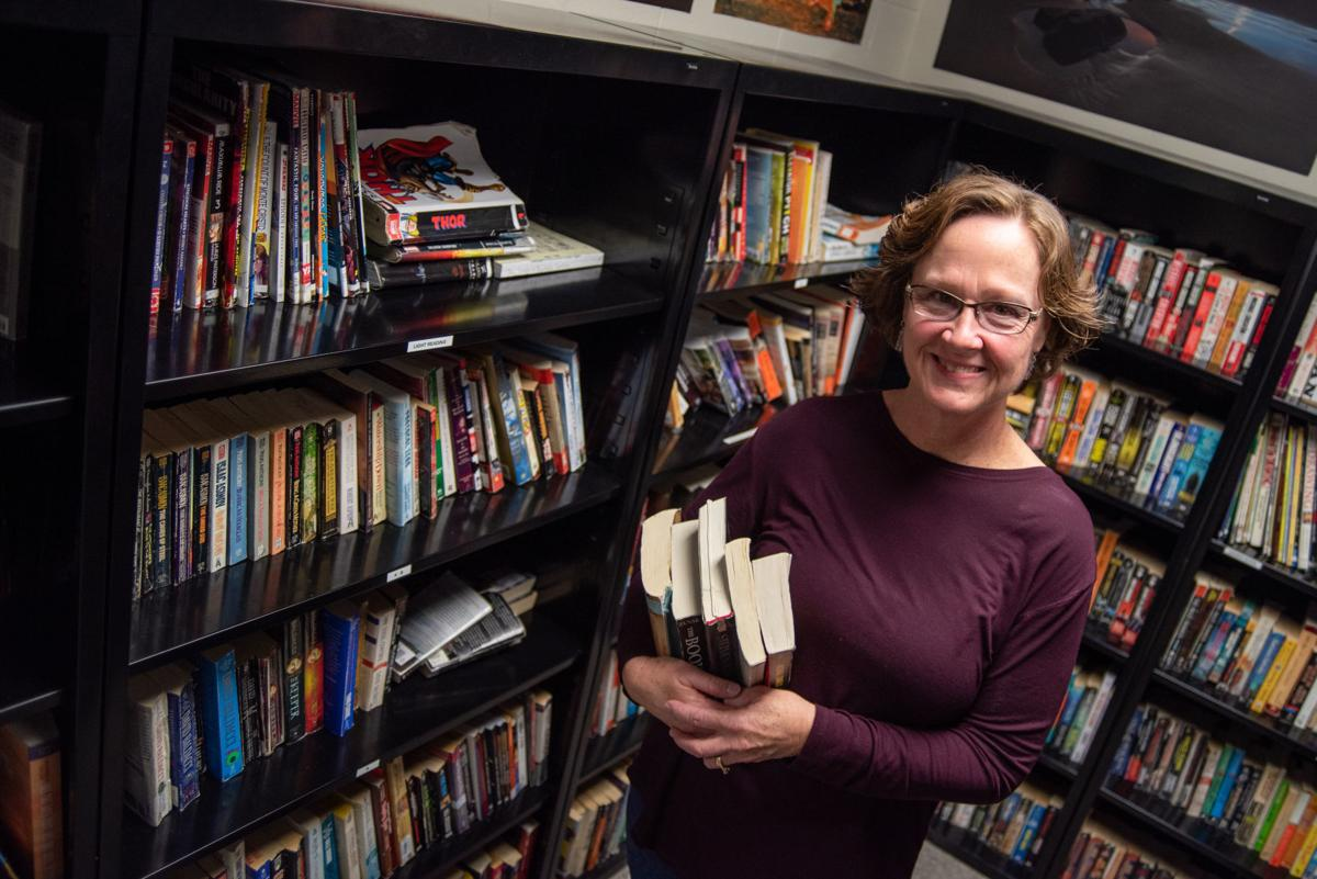 Riley County Jail librarian, Kathy Paul, stands inside of the library.