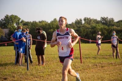 Daniel Harken, senior, pushes forward getting 2nd overall. The Cross County meet was held at Warner Park early Saturday morning where 10 schools competed.