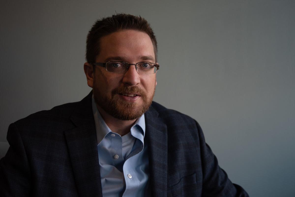 Aaron Estabrook sits inside the Aggieville Business Association