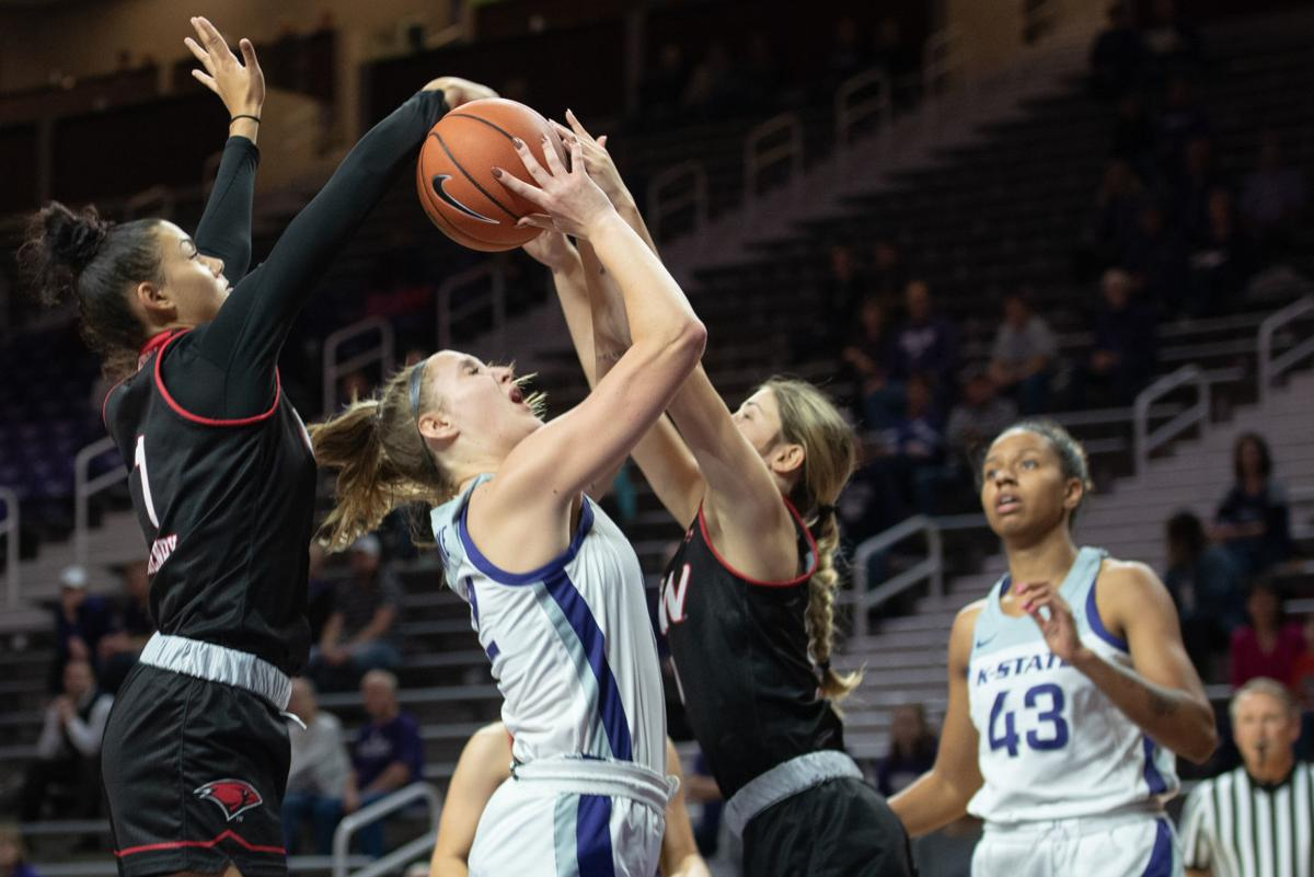 Rachel Ranke (12) attempts to go up for a lay-up aganist Alexis Henry (1) and Macy Ray (0)