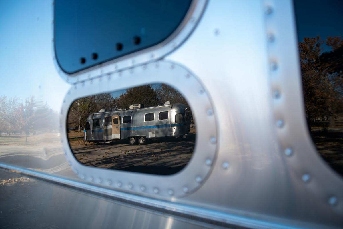 An Airstream is reflected in the window of another Airstream