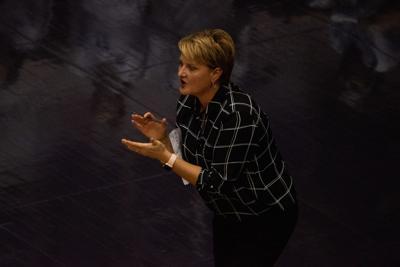 K-State volleyball head coach Suzie Fritz claps