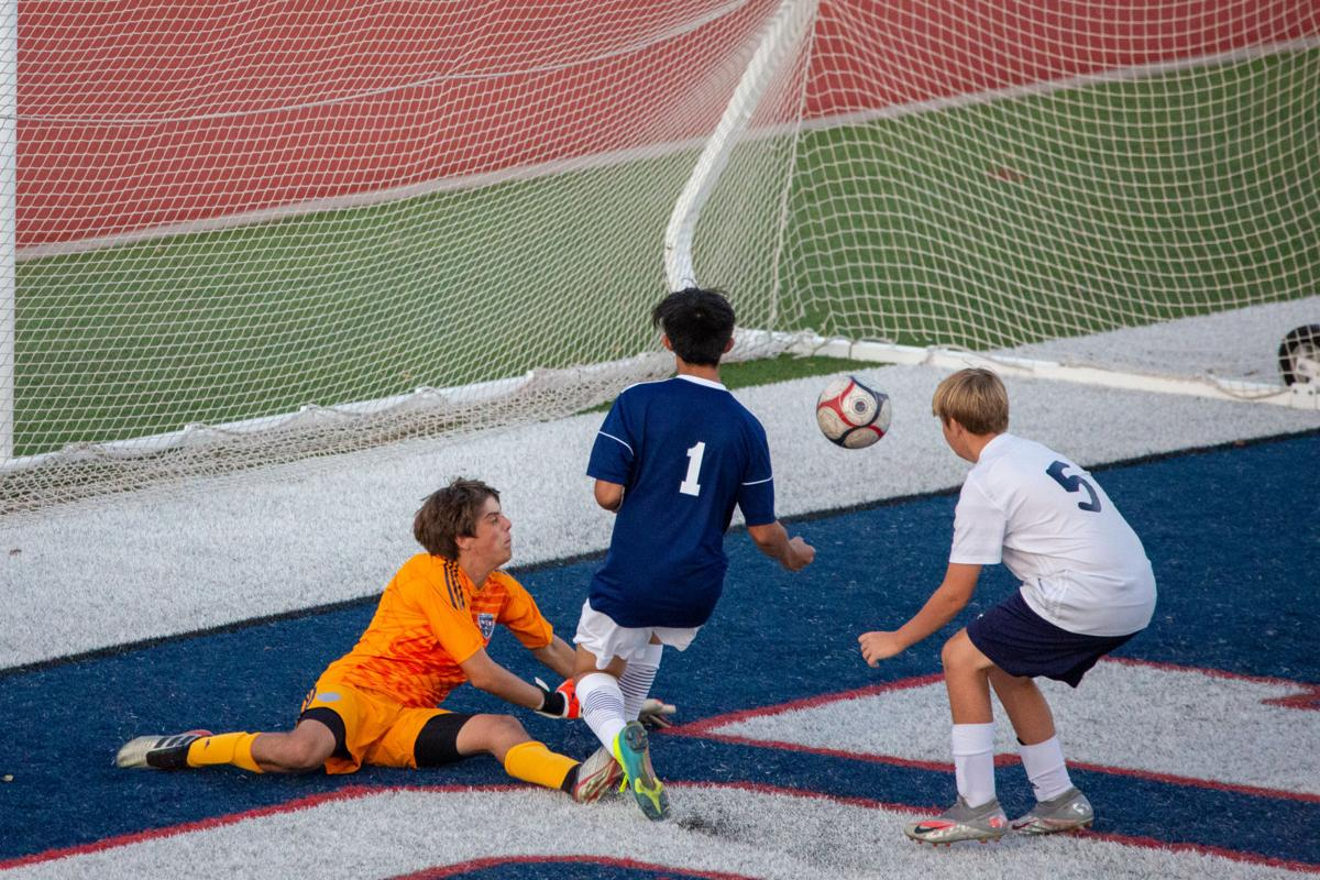Gedrick Comiso (1) beats out Hayden's Gus Goltzbach (5) scoring the first goal of the game. Manhattan Indians beat out Hayden 3-0 Tuesday night.