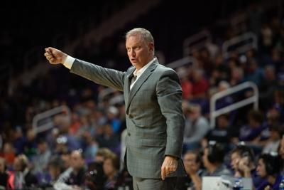 K-State head coach Jeff Mittie gives his team hand signals from the sideline during the third quarter.