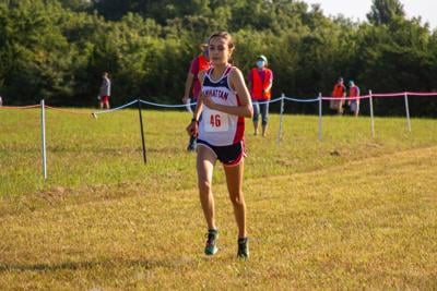 Jenna Keeley, a junior, finishes first overall for varsity girls. The Cross County meet was held at Warner Park early Saturday morning where 10 schools competed.