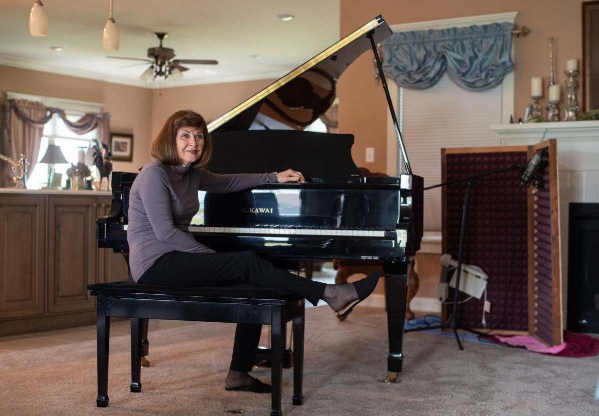 Jan Barkey sits next to her Kawai Grand Piano in her home on Saturday morning. Barkey has taught 30-35 piano students in Manhattan since 1997.
