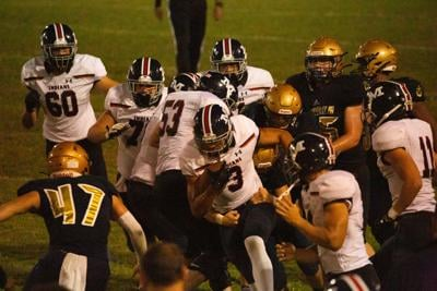 Joe Hall wide receiver pushes forward with a pile of players. Manhattan played Hayden Friday night loosing 42-28 at Hayden High School.