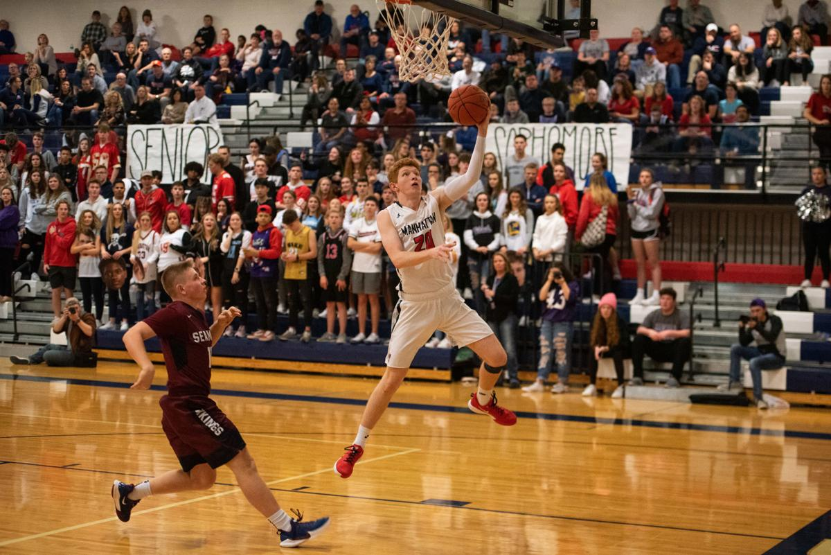 Mitch Munsen (20) makes a lay-up on a fast break during the third quarter.