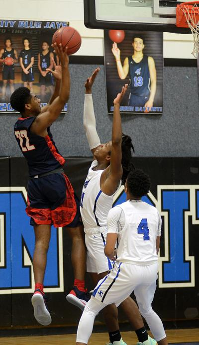 Manhattan boys basketball defeats Junction City 46-44
