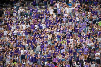 Fans cheer in stands close to one another in the student section. The Kansas State Wildcats faced off against Arkansas State wolves on Saturday at Bill Snyder Family Stadium, Arkansas State beat Kansas State 35 to 31.