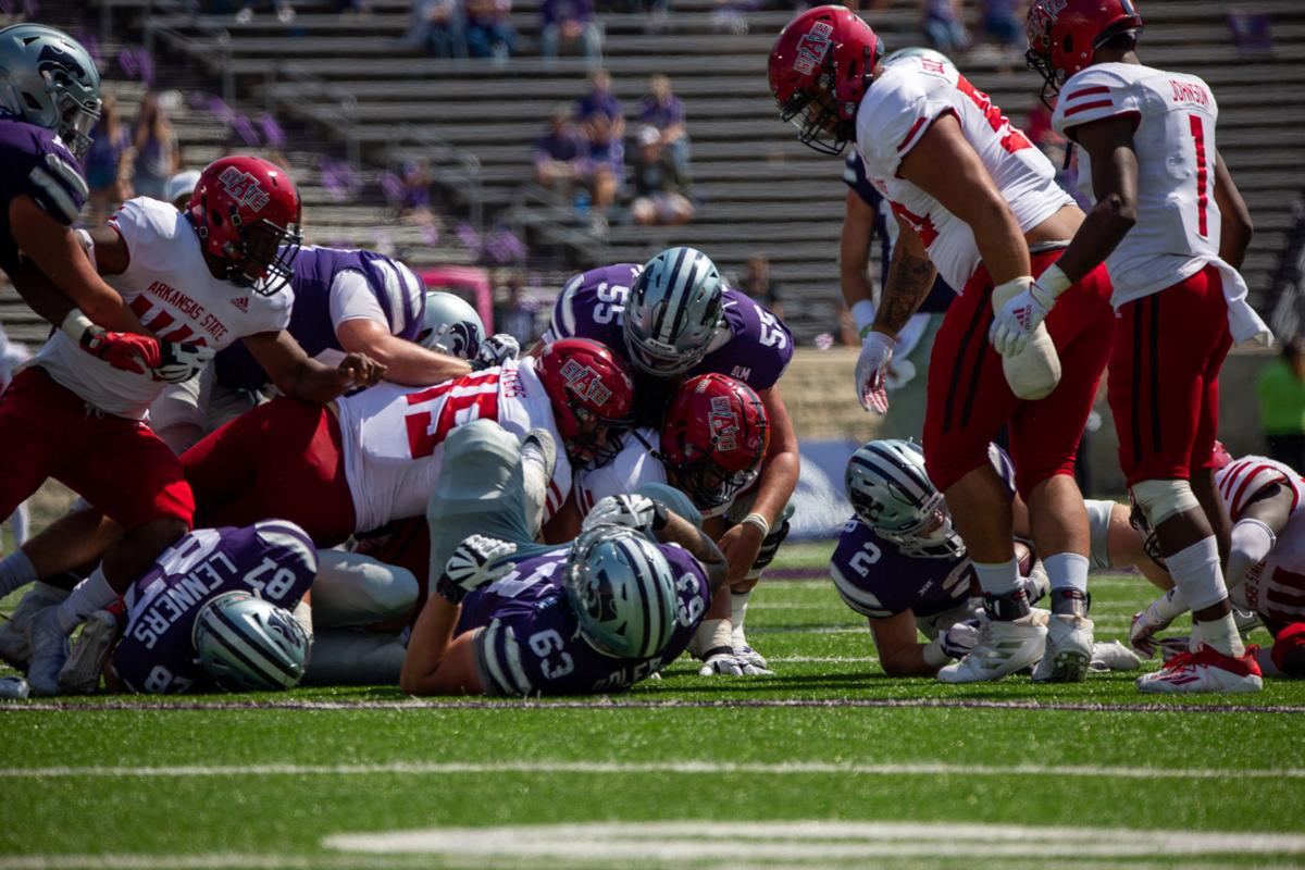 A wall of Arkansas State defense rush into Kansas State team. The Kansas State Wildcats faced off against Arkansas State wolves on Saturday at Bill Snyder Family Stadium, Arkansas State beat Kansas State 35 to 31.