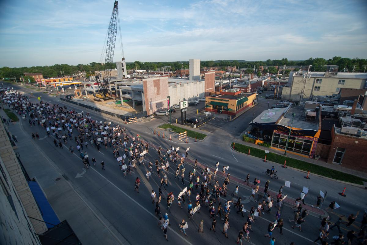Protestors march down Bluemont Avenue during protest on Tuesday.