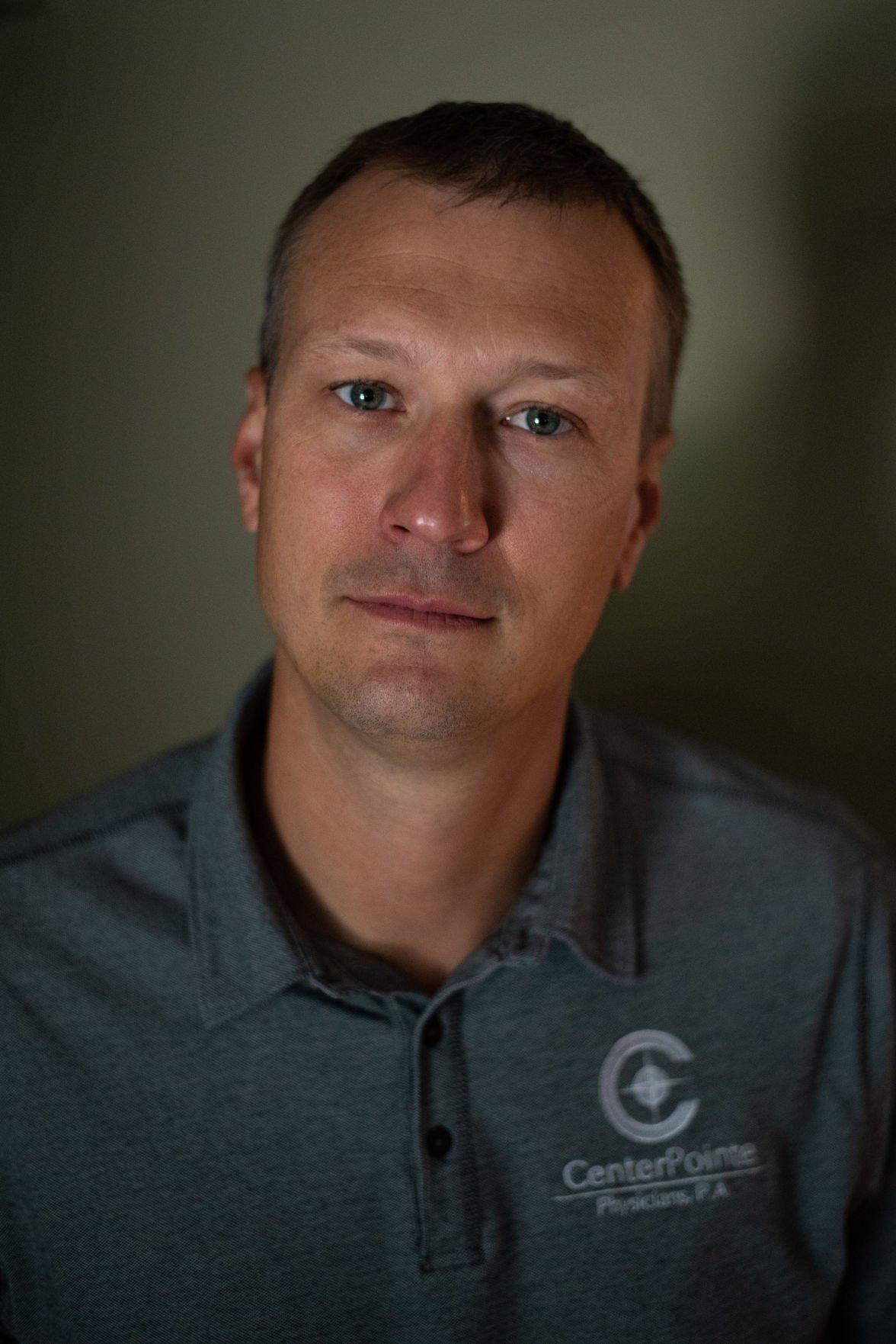 Matt Floersch stands in his living room on Friday.