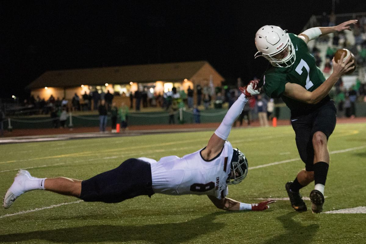 Tyce Hoover (8) gets called for a horse collar Grant Adler (7)