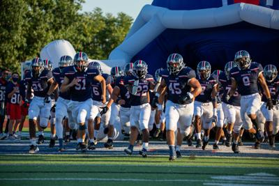 The Indians run full force at their first official game of the year. Manhattan High School Indians beat the Garden City Buffalos 21 to 7 on Friday night at Bishop Stadium.