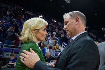 K-State head coach Jeff Mittie talks to Baylor head coach Kim Mulkey after his Wildcats lose 54-40 against the Lady Bears.