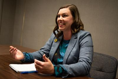 Kali Barnett, who is running as a Democrat in the Kansas First Congressional District, speaks to Rafael Garcia in the conference room at The Manhattan Mercury.