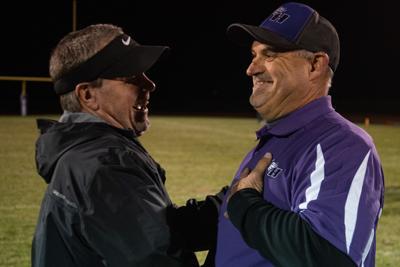 Centralia head coach Larry Glatzak and Valley Heights head coach Tony Trimble talk