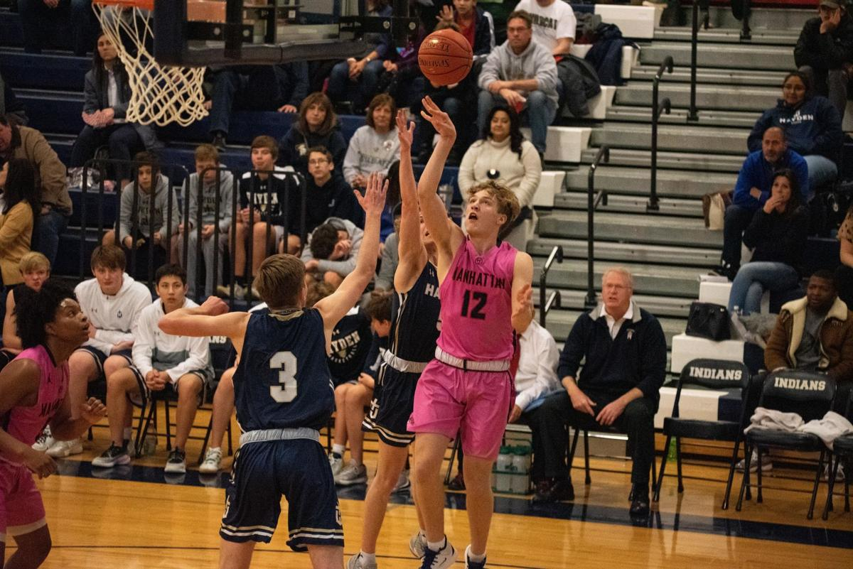 Owen Braxmeyer (12) attempts a shot while being guarded by Cade Pavilk (3).