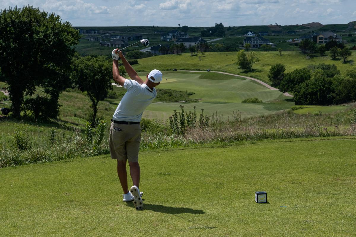 Jared Helin drives the ball on Hole 15 just left of the fairway.