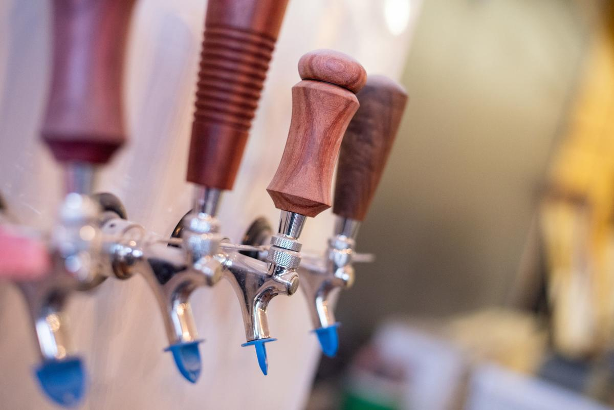 Beer taps are seen inside of Manhattan Brew Co.