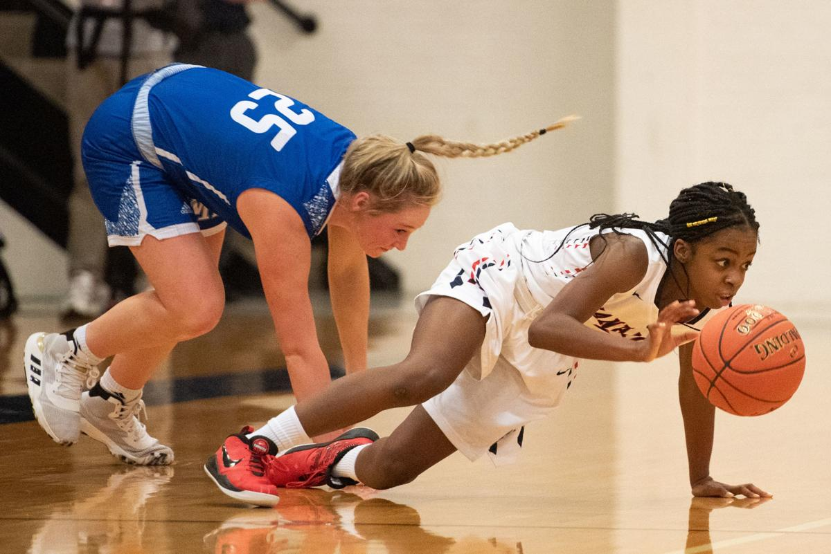 Destiny Yates (1) dives on a loose ball after knocking it loose from Kasey Hamilton (25).