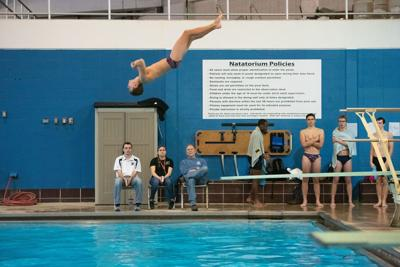Zeke Kohl jumps off of the diving board during the 1meter diving competition.