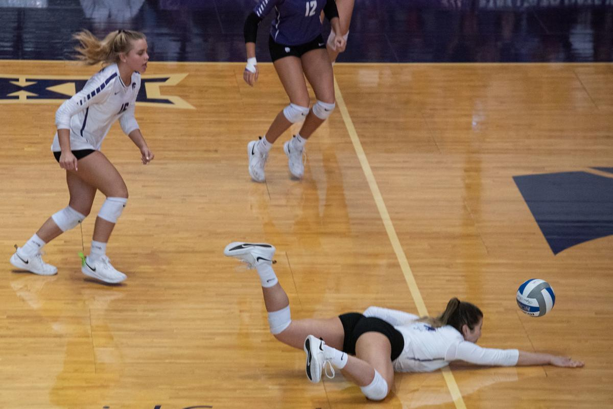 Sarah Dixon (4) dives on the floor and digs the ball to a teammate to keep the play alive