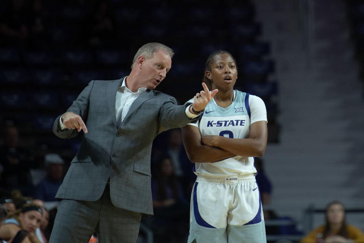 K-State head coach Jeff Mittie talks to Cymone Goodrich (2)