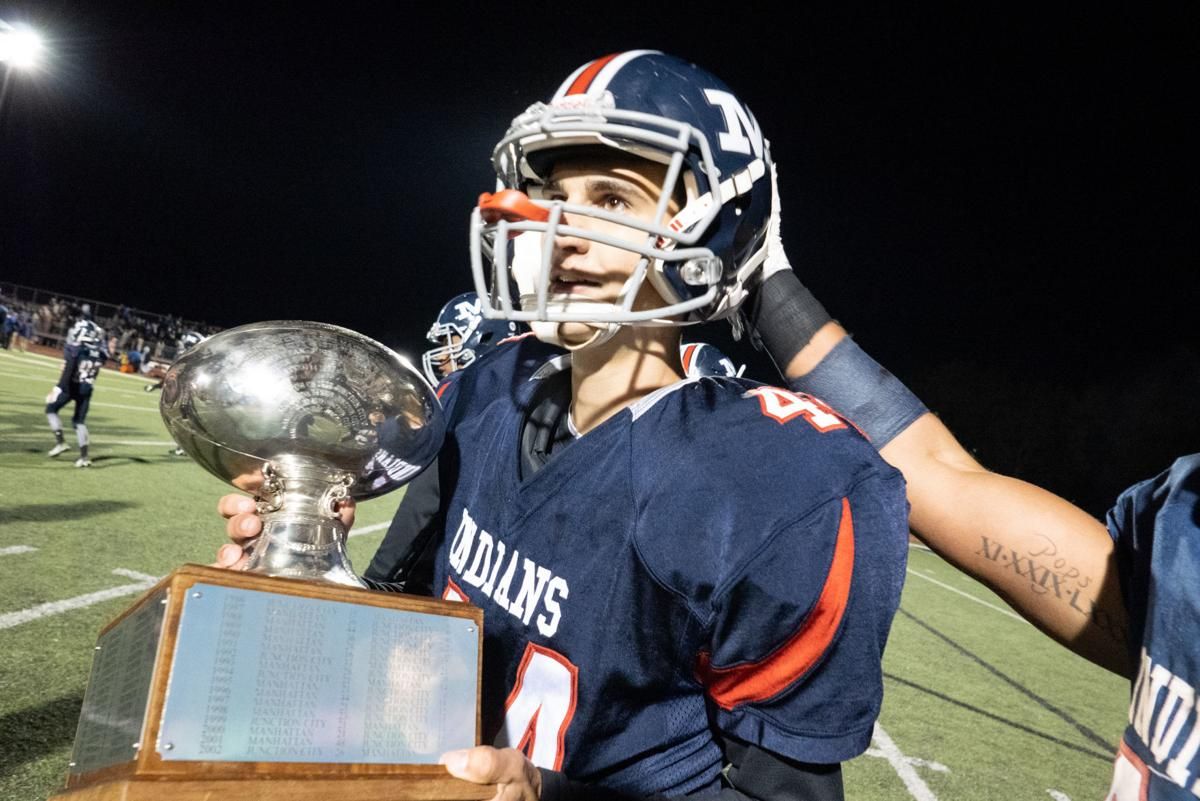 Grant Snowden holds the trophy