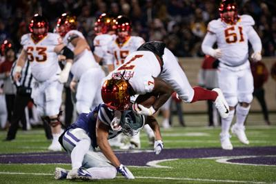 Jahron McPherson (31) tackles La'Michael Pettway (7) on Iowa State's first drive down the field.