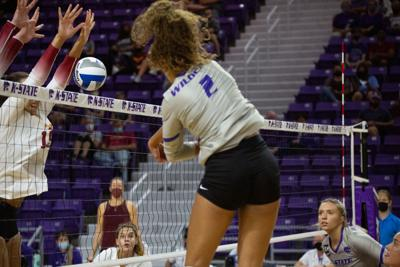 Aliyah Carter (2) spikes to the side of defensive blockers landing a kill. K-State Volleyball faced Iowa State on Saturday night beating out Iowa 3-1 sets at Bramlage Coliseum.