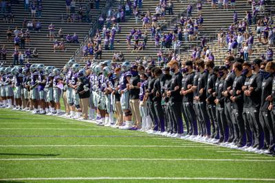 Players lock hands for a moment of unity as fans cheer. The Kansas State Wildcats faced off against Arkansas State wolves on Saturday at Bill Snyder Family Stadium, Arkansas State beat Kansas State 35 to 31.