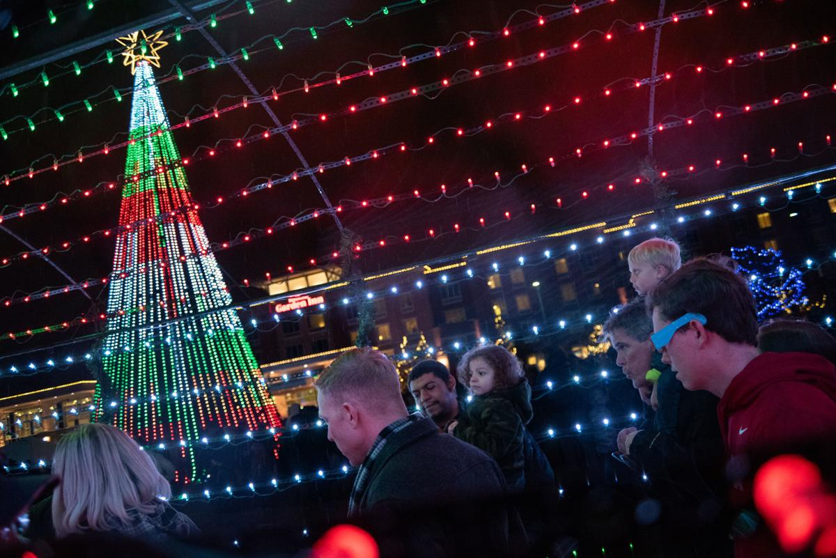 A tunnel of LED lights is built around the Christmas tree at Blue Earth Plaza