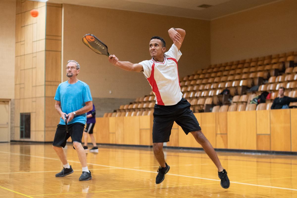 Bo Tolbert volleys the ball over the net