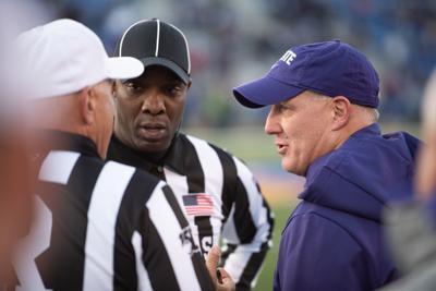 Head coach Chris Klieman talks with referees
