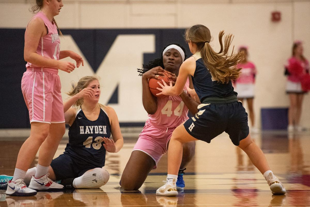 Zanaa Cordis (44) grabs a loose ball from Haley Karolevitz (14).