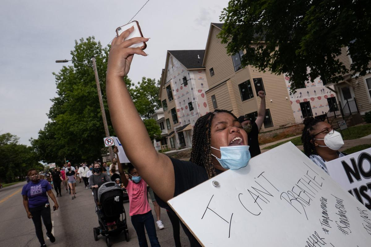 Zanaiya Peebles marches down Bluemont Avenue in honor of George Floyd on Saturday.
