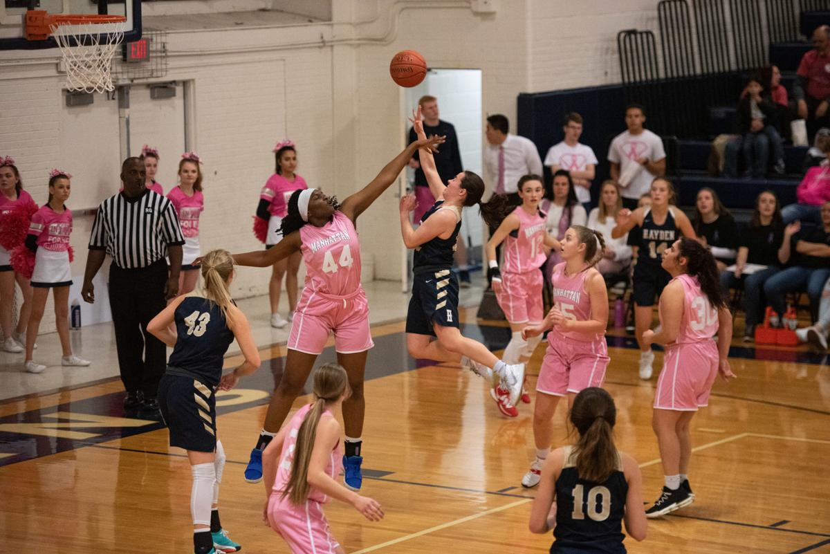 Sophia Purcell (32) attempts a shot while being guarded by Zanaa Cordis (44).