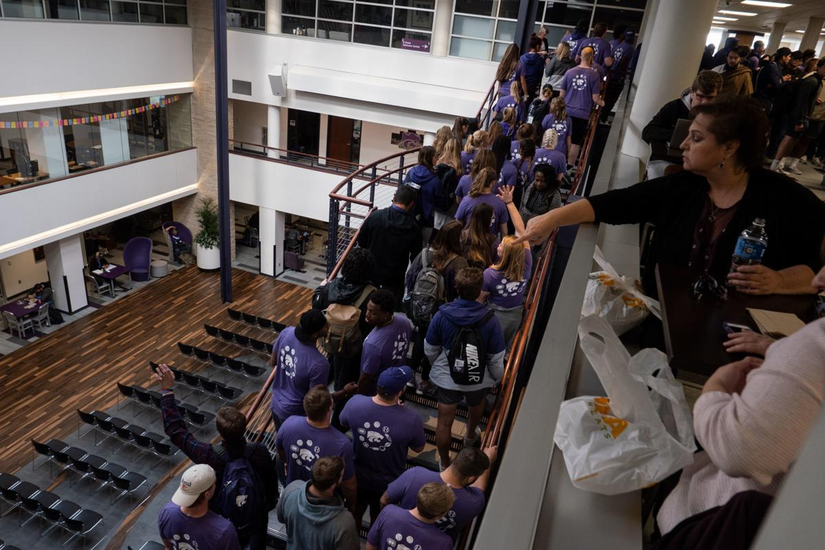 K-State athletes and students walk through the K-State Union