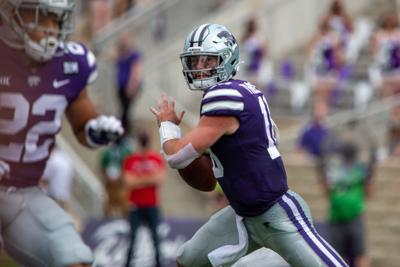 Skylar Thompson, senior quarterback, looks for an opening. The Kansas State Wildcats faced off against Arkansas State wolves on Saturday at Bill Snyder Family Stadium, Arkansas State beat Kansas State 35 to 31.