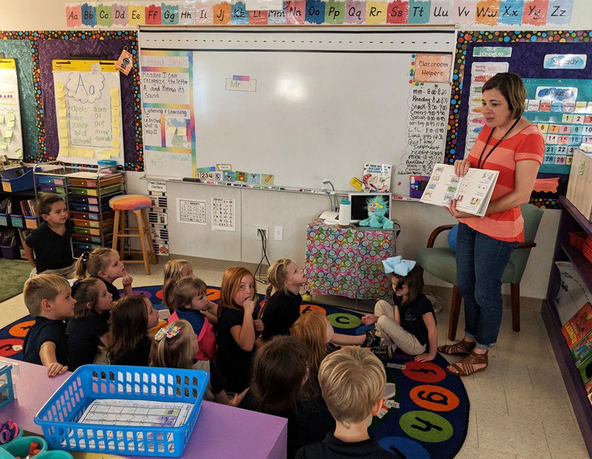 Shining Rock teacher Amanda Muri teaching Spanish to Kindergarten