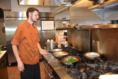 Nicholas Peek preparing a dish