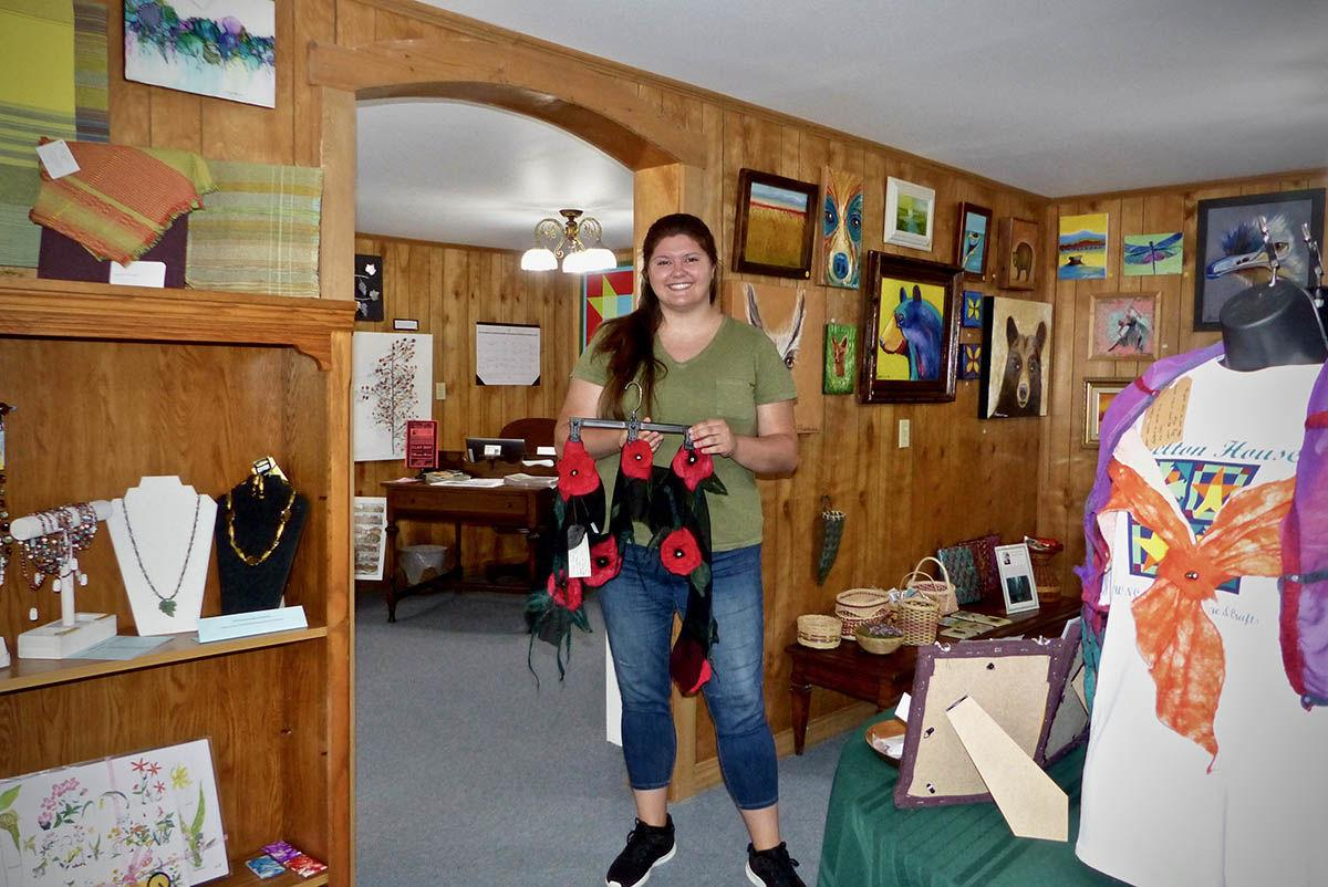 Miranda Black in Shelton House Gift Shop holding Jeannette Carter felted scarf