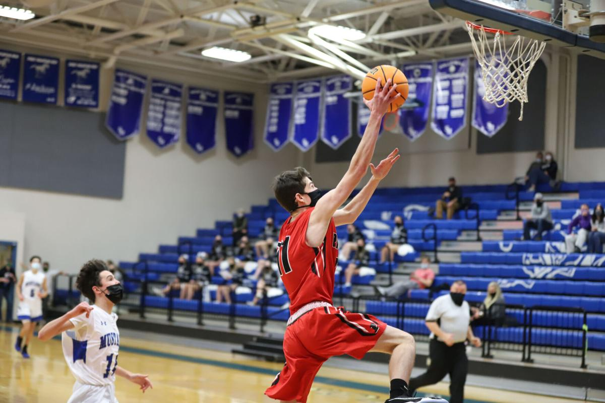 Senior Brady Goolsby surprises everyone with a dunk-2.jpg