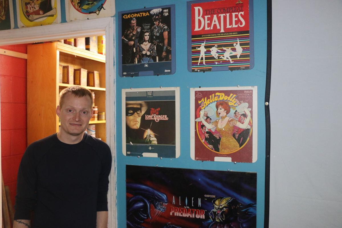 Chris with movies.JPG