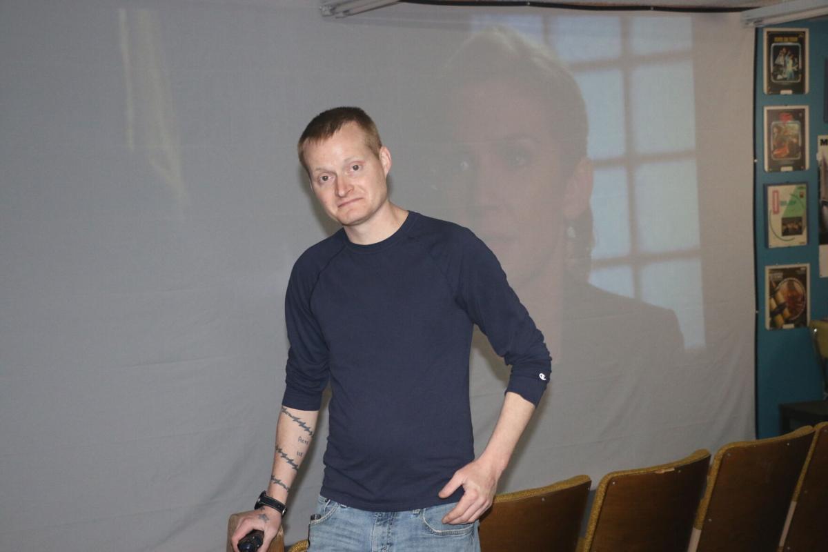 Chris with screen.JPG